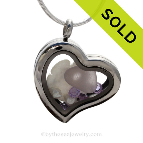 Lavender sea glass with seafan and fresh water pearls and lavender crystal gems.