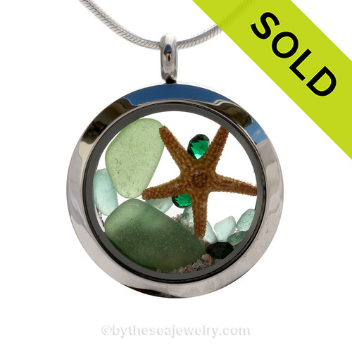 Beautiful pieces of perfect Genuine Green Sea Glass combined with and Two Real Starfish. Finished with crystal emerald gems and tiny aqua bits in this heart locket. SOLD - Sorry this Sea Glass Locket is NO LONGER AVAILABLE!