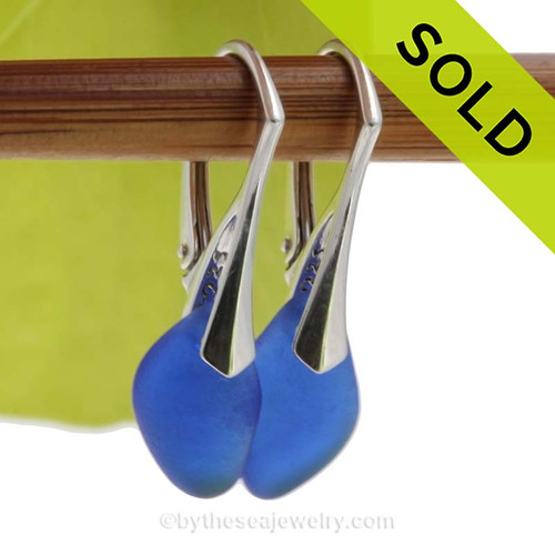 Genuine Beach Found Blue Sea Glass Earrings on Sterling Silver Leverbacks. We meticulously sort though hundreds of pieces of beach found sea glass to find one pair that is similar in shape, size and hue! SOLD - Sorry these Rare Sea Glass Earrings are NO LONGER AVAILABLE!