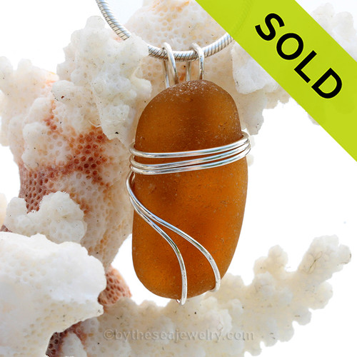 A large thick piece of vivid amber brown sea glass set in our triple sterling silver setting. SOLD - Sorry This Sea Glass Pendant is NO LONGER AVAILABLE!