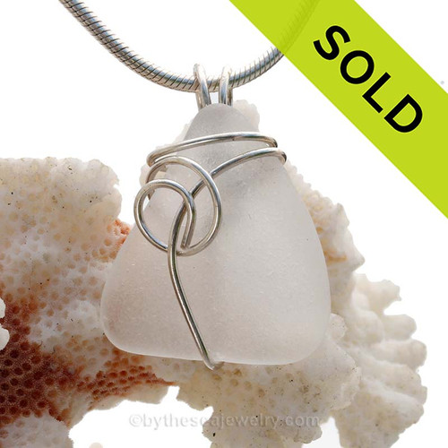 A perfect piece of TOP QUALITY white sea glass set in our simple and popular sea Swirl setting in sterling. Simple and clean this Genuine Sea Glass Pendant with go with everything any time of year.  SOLD - Sorry this Sea Glass Jewelry piece is NO LONGER AVAILABLE!