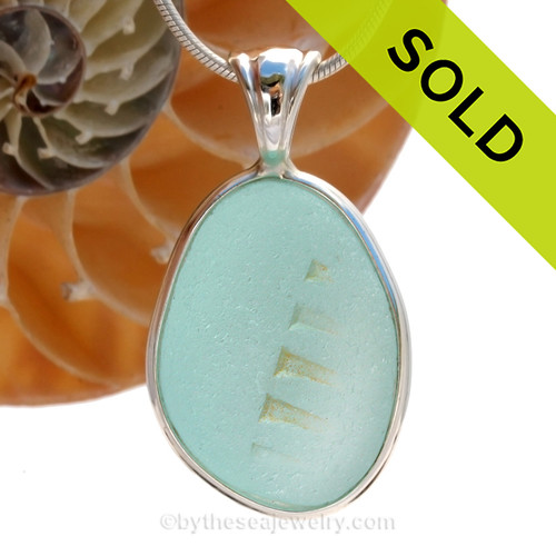 A wonderful shaped bottle bottom piece of Aqua Blue sea glass in our In Our Deluxe Sterling Wire Bezel© necklace pendant.