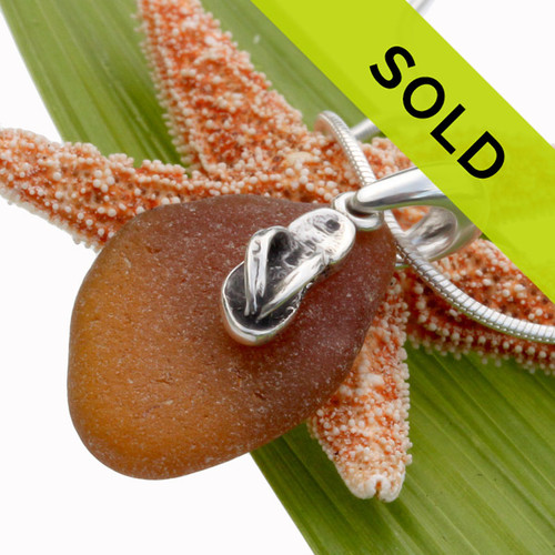 Sorry this amber sea glass pendant with flip flop has been sold!