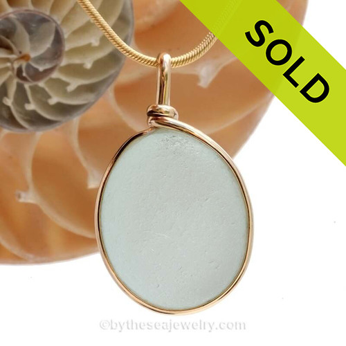 This is a beautiful LARGE and ROUND Seaham Bright Aqua Sea Glass set in our Original Wire Bezel© pendant setting with 14K rolled gold. This is our Original By The Sea Jewelry Bezel Wire© design that leaves the glass UNALTERED from the way it was found on the beach. Beautiful and versatile.