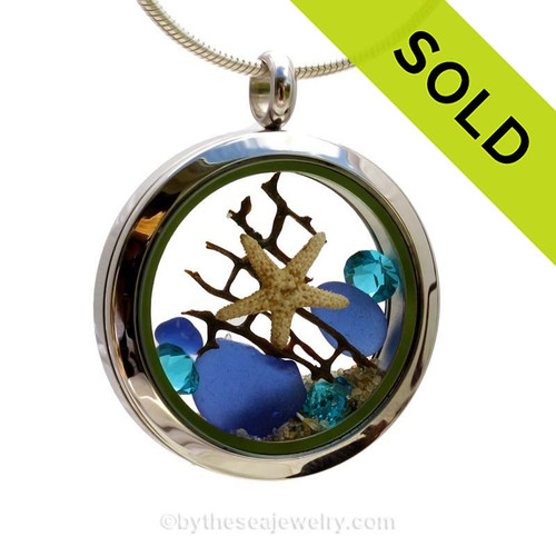 """Beautiful piece of cobalt blue genuine sea glass piece combined with a real starfish and vintage seafan . Finished with a vivid brilliant cut Zircon gems """"and finished with real beach sand. SOLD - Sorry this Sea Glass Locket is NO LONGER AVAILABLE!"""