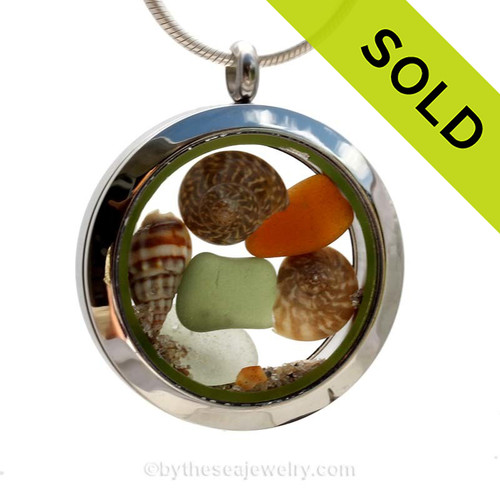 SOLD - Sorry this Sea Glass Locket is NO LONGER AVAILABLE! Seaweed and Seafoam Green and Amber sea glass combined a tiny beach shells in the Genuine Sea Glass Locket. Beach sand completes your own personal beach on the go.