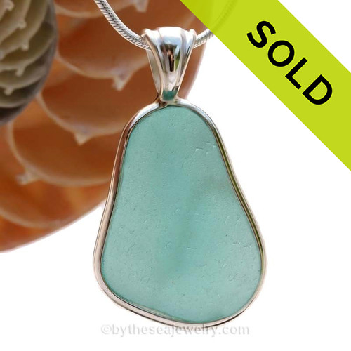 A wonderful PERFECT and HUGE piece of Vivid Aqua Genuine Sea Glass in our In Our Deluxe Sterling Wire Bezel© Necklace Pendant. SOLD - Sorry this Rare Sea Glass Pendant is NO LONGER AVAILABLE!