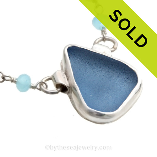 A Perfect piece of Periwinkle or Carolina Blue sea glass from set in an artisan fine and sterling silver backed bezel necklace. Presented on a fine sterling silver aquamarine and pearl chain. SOLD - Sorry this  Rare Sea Glass Necklace is NO LONGER AVAILABLE!