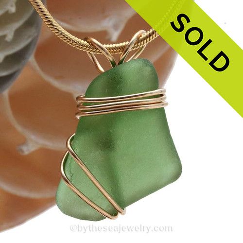 Green sea glass in a in a triple wire wrapped Sea Glass Pendant. SOLD - Sorry This Sea Glass Pendant is NO LONGER AVAILABLE!