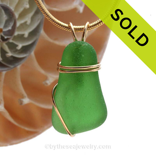 A nice smaller bright green genuine sea glass piece set in our simple rolled gold setting. SOLD - Sorry this Sea Glass Pendant is NO LONGER AVAILABLE!