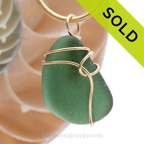 SOLD - Sorry this Sea Glass Pendant is NO LONGER AVAILABLE! A Beautiful Jungle Green Genuine Sea Glass piece set in our simple and secure Deco Inspired  14K rolled gold setting.