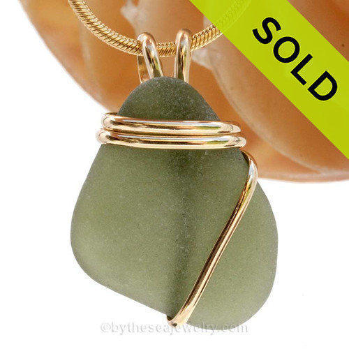 A Beautiful Jungle Green Genuine Sea Glass piece set in our Deluxe Wire Wrapped 14K rolled gold setting. SOLD - Sorry this Sea Glass Pendant is NO LONGER AVAILABLE!