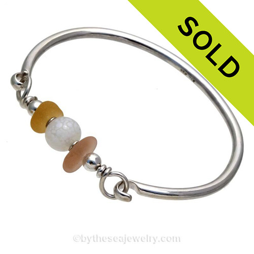 Ultra Rare Gold and Depression Pink Genuine Sea Glass Bangle Bracelet set with a vintage Opalized Bead and finished in sterling details on a Solid Sterling Round Bangle Bracelet. SOLD - Sorry this Sea Glass Jewelry selection is NO LONGER AVAILABLE!