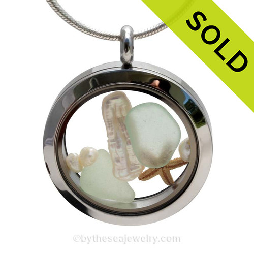 Genuine Seafoam sea glass pieces combined with a real baby genuine pearls and a tiny starfishin this stainless steel locket. SOLD - Sorry this Sea Glass Locket is NO LONGER AVAILABLE!