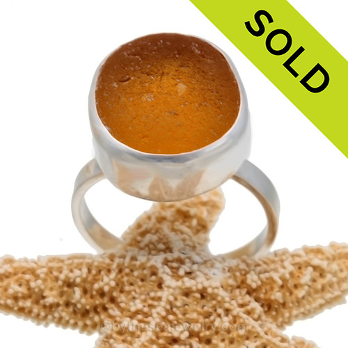 A stunning piece of VIVID Orange Yellowy sea glass from Seaham England and the site of Victorian era glass factories is set in a solid sterling silver and fine silver bezel set ring. SOLD - Sorry this Ultra Rare Sea Glass Ring is NO LONGER AVAILABLE!!!