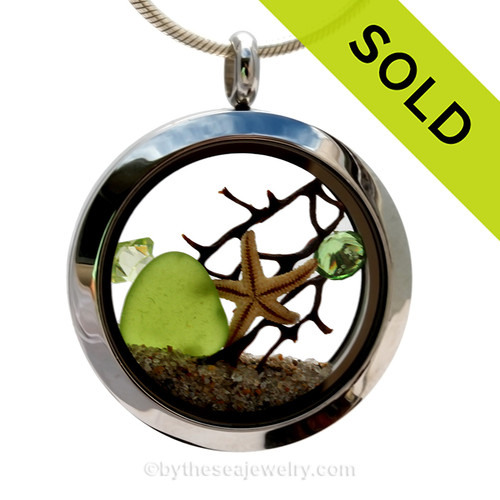 Genuine lime green sea glass piece combined with a small REAL starfish a real beach sand in this stainless steel locket. Finished with a  vivid peridot crystal gem for a bit of beachy bling. SOLD - Sorry this Sea Glass Locket is NO LONGER AVAILABLE!
