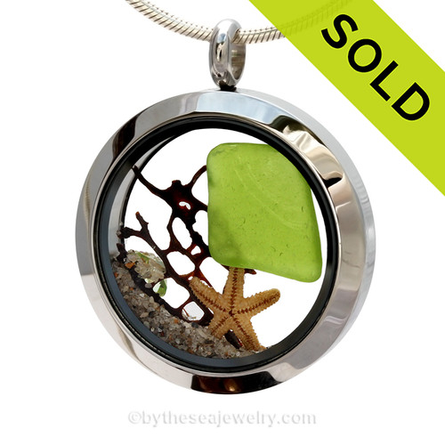 Embossed Genuine lime green Sea Glass piece combined with a small REAL starfish a real beach sand in this stainless steel locket. Finished with a  vivid peridot crystal gem for a bit of beachy bling. SOLD - Sorry this Sea Glass Locket is NO LONGER AVAILABLE!
