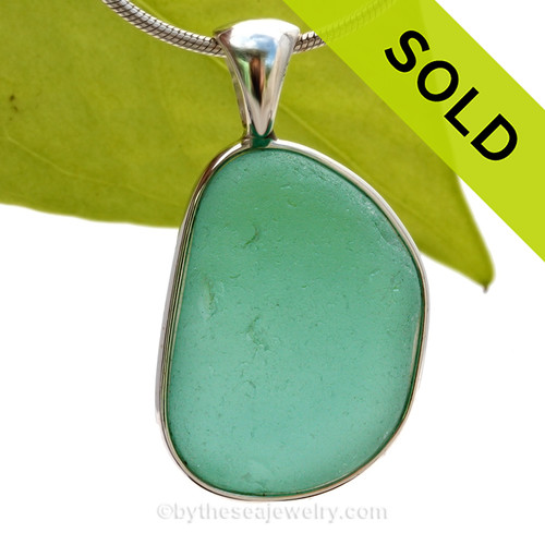 This is a LARGE and flatter Aqua Green Genuine Sea Glass Pendant set in our Original Wire Bezel© pendant setting in Sterling Silver. SOLD - Sorry this Rare Sea Glass Pendant is NO LONGER AVAILABLE!