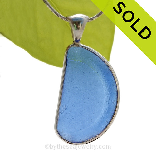 This is a beautiful and LARGE Medium Blue Bottle Bottom Sea Glass Pendant set in our Original Deluxe Wire Bezel© pendant setting in Sterling Silver . SOLD - Sorry this Rare Sea Glass Pendant is NO LONGER AVAILABLE!