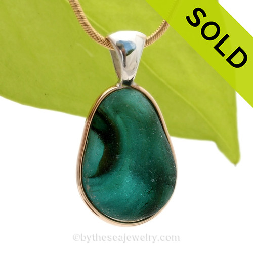 This amazing water color multi color sea glass in green and aqua and a versatile in a mixed metal Deluxe Wire Bezel© pendant setting. Originating as end of day art glass tossed into the sea and rolled around for over 100 years. Glass from this region tends to be the best in the world. SOLD - Sorry this Ultra Rare Sea Glass Pendant is NO LONGER AVAILABLE!
