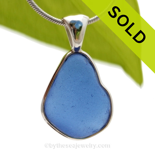 This is a beautiful and VIVID Medium Blue Sea Glass Pendant set in our Deluxe Wire Bezel© pendant setting in Sterling Silver. This design that leaves the glass UNALTERED from the way it was found on the beach. Beautiful, Classic and Versatile. SOLD - Sorry this Rare Sea Glass Pendant is NO LONGER AVAILABLE!