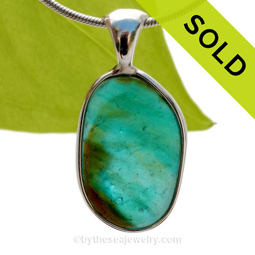 A Lovely Medium Sized Mixed Electric Aqua and Peridot Green Seaham multi sea glass set in Sold Sterling Silver Deluxe Wire Bezel© pendant setting. SOLD - Sorry this Ultra Rare Sea Glass Pendant is NO LONGER AVAILABLE!