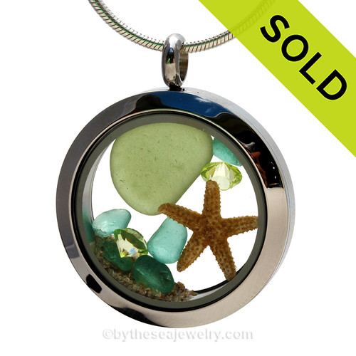 Genuine peridot green Sea Glass Locket with a small REAL starfish a real beach sand in this stainless steel locket. Finished with a  vivid peridot crystal gems for a bit of beachy bling.  SOLD - Sorry this Sea Glass Locket is NO LONGER AVAILABLE!