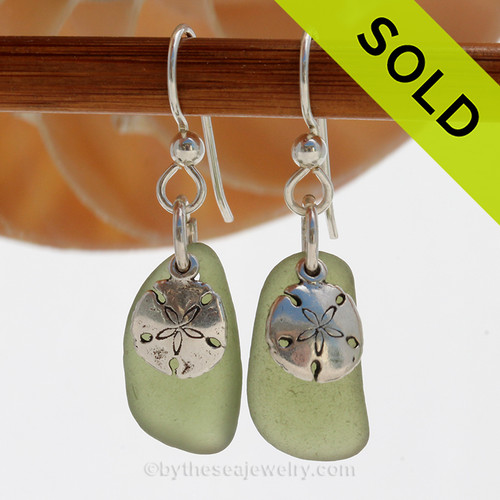 A simple pair of green Genuine Sea Glass Earrings with sterling beachy Sandollarp charms in a lightweight simple setting. SOLD - Sorry these Sea Glass Earrings are NO LONGER AVAILABLE!
