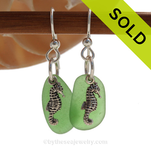 Natural beach found green sea glass pieces are set with solid sterling Sea Horse charms and are presented on sterling silver fishook earrings. SOLD - Sorry these Sea Glass Earrings are NO LONGER AVAILABLE!