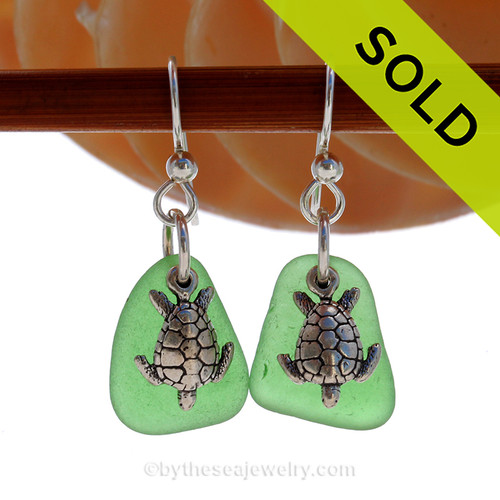 Natural beach found green sea glass pieces are set with solid sterling Sea Turtle charms and are presented on sterling silver fishook earrings.  SOLD - Sorry these Sea Glass Earrings are NO LONGER AVAILABLE!