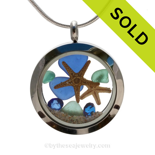 Beautiful natural cobalt dark blue and aqua sea glass pieces combined in a stainless steel locket necklace a two real starfish and beach sand and sapphire gems. SOLD - Sorry this Sea Glass Locket is NO LONGER AVAILABLE!