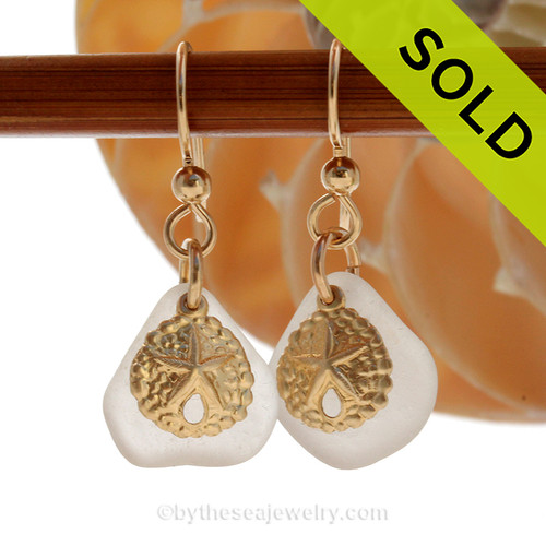 Beautiful Pure White Sea Glass Earrings with 14K Goldfilled Sandollar  charms naturally tumble by tide and time.  Simple and elegant with genuine beach found UNALTERED sea glass pieces. Sorry these Sea Glass Earrings have been SOLD