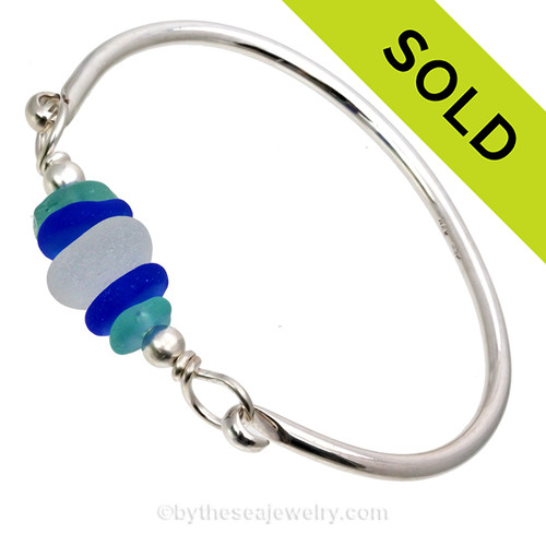 Genuine Blue, White and Aqua Sea Glasss on this solid sterling full Round Sea Glass Bangle Bracelet. This is finished in solid sterling beads. SOLD - Sorry this Sea Glass Bangle Bracelet is NO LONGER AVAILABLE!