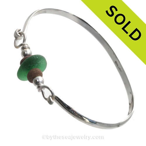Vivid Kelly Green Genuine English Sea Glass & Natural Beach Stones on this Solid Sterling Silver Half Round Sea Glass Bangle Bracelet. This is finished in solid sterling beads. SOLD - Sorry this Sea Glass Bangle Bracelet is NO LONGER AVAILABLE!
