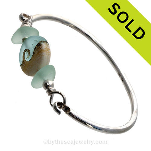 Seafoam Green  Genuine Sea Glass Bangle Bracelet set with a handmade lampwork glass wave bead set with sterling details on a solid sterling round bangle bracelet. SOLD - Sorry this Sea Glass Bangle Bracelet is NO LONGER AVAILABLE!