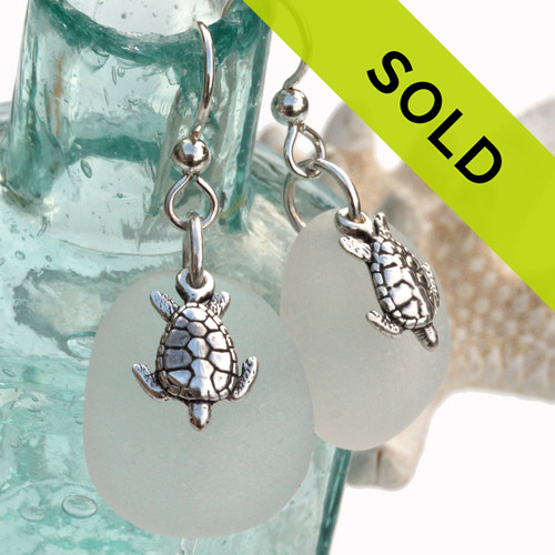 Larger perfect pieces of pure white sea glass are set with solid sterling sea turtles on french earwires. A nice larger pair of earrings!  Sorry this pair of sea glass earrings has SOLD!