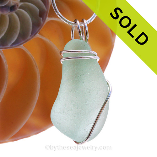 Vivid bright Seafoam well aged Genuine Sea Glass Pendant in a Solid Sterling Silver Basic Wirewrap.