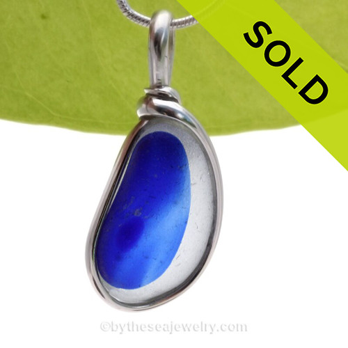 A Lovely Petite Jellybean shaped Mixed Electric Blue and White Seaham multi sea glass set in Sold Sterling Silver Deluxe Wire Bezel© pendant setting.  Originating as end of day art glass tossed into the sea. Glass from this region tends to be the best in the world. Most likely the remnants of a broken attempt of a vintage Hartley and Wood vase Circa 1900, the historical source of this amazing sea glass pendant piece. Color is NOT APPLIED but was fused into the glass over 100 years ago.