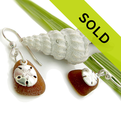 This pair of amber sea glass earrings with sandollar charms have sold!