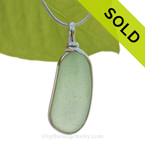 This is a beautiful Seafoam Green Sea Glass set in our Original Wire Bezel© pendant setting in Sterling Silver .