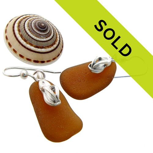 Brown sea glass earrings  with sterling flip flop charms.