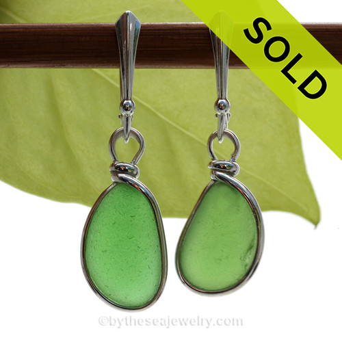 Vivid Mermaids Emeralds in Green Glowing Sea Glass Earrings set in our Original Wire Bezel  Setting lets all the beauty of these beauties shine!  This setting does not alter the sea glass from the way it was found on the beach. SOLD - Sorry these Sea Glass Earrings are NO LONGER AVAILABLE!