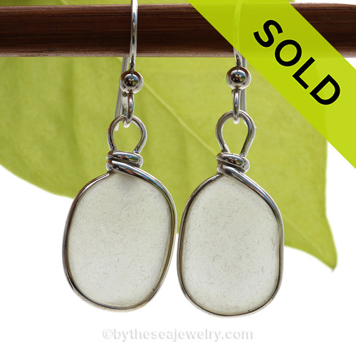 A lovely pair of pure white Genuine Sea Glass Earrings in our Original Bezel Wire© setting in solid sterling silver.