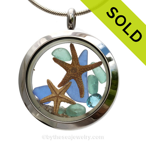 Genuine aqua and blue sea glass pieces combined with a two real starfish and crystal aqua gems stainless steel locket.