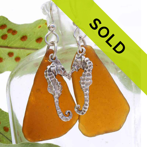 Sorry these brown sea glass earrings with seahorse charms have been sold!
