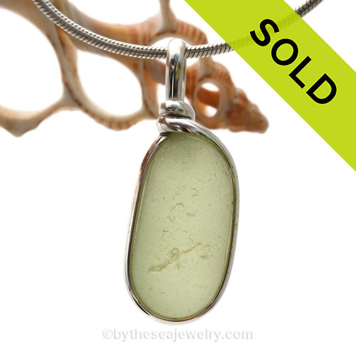 This is a P-E-R-F-E-C-T piece of light Perdiot Green Sea Glass Jewelry set in our Original Wire Bezel© pendant setting in Sterling Silver . This is our signature Original Wire Bezel© design that leaves the glass UNALTERED from the way it was found on the beach. Beautiful, Classic and Versatile.