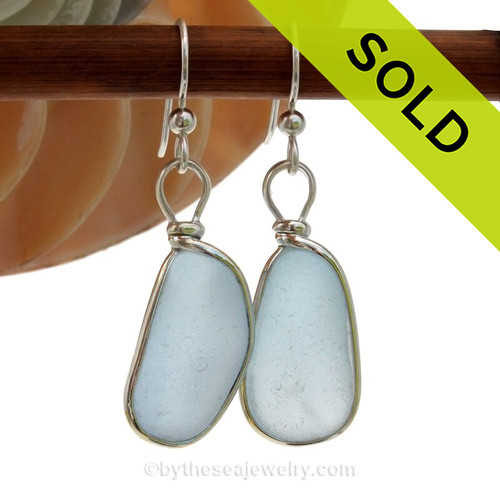 Rich thcik Baby Blue sea glass pieces from the Sea Of Japan are set in our Original Wire Bezel© earring setting.