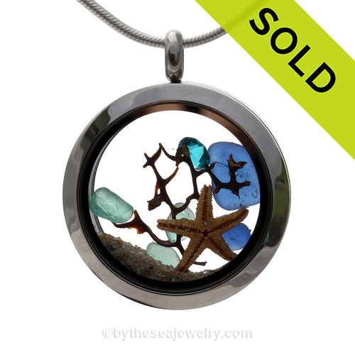 Genuine Cobalt Blue and Aqua sea glass pieces combined with a Real Starfish and Crystal Aqua gem in a premium Stainless Steel Twist Top Locket. SOLD - Sorry this Sea Glass Locket is NO LONGER AVAILABLE!