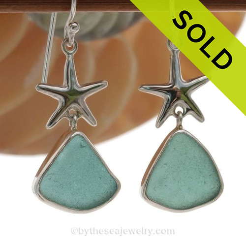 A stunning pair of pale aqua sea glass earrings set in a finely crafted setting in sterling silver. Once in a lifetime pair! SOLD - Sorry these Rare Sea Glass Earrings are NO LONGER AVAILABLE!