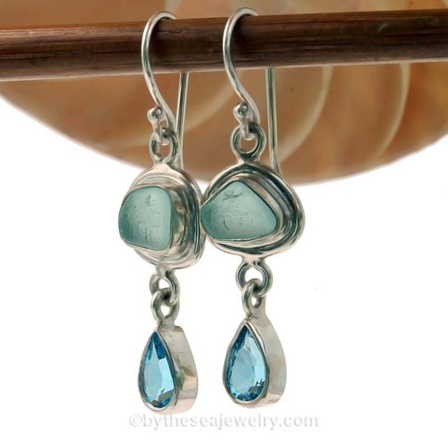 Stunning Aqua Sea Glass Earrings set in Fine and Sterling Silver and Genuine Blue Teardrop cut Topaz Gems. These stunning artisan crafted Sea Glass earrings are beautifully set in sterling silver.
